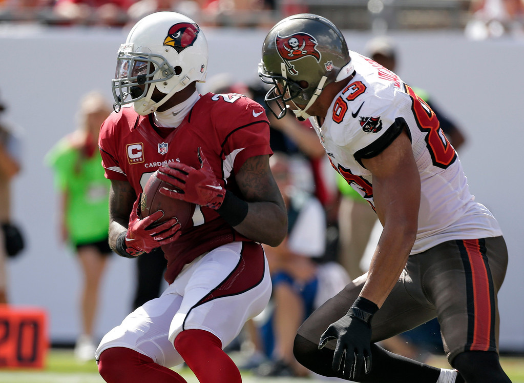 . Arizona Cardinals cornerback Patrick Peterson (21) intercepts a pass intended for Tampa Bay Buccaneers wide receiver Vincent Jackson (83) during the fourth quarter of an NFL football game on Sunday, Sept. 29, 2013, in Tampa, Fla. (AP Photo/Chris O\'Meara)