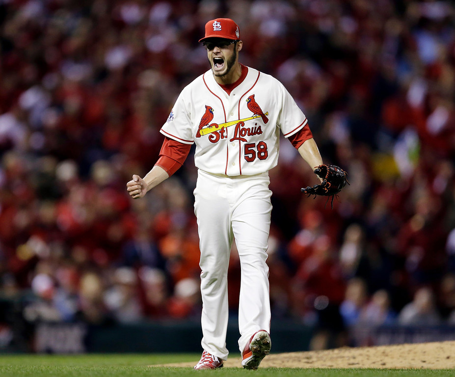 . St. Louis Cardinals starting pitcher Joe Kelly reacts after getting Boston Red Sox\'s Daniel Nava to strike out and end the top of the fourth inning of Game 3 of baseball\'s World Series Saturday, Oct. 26, 2013, in St. Louis. (AP Photo/Jeff Roberson)