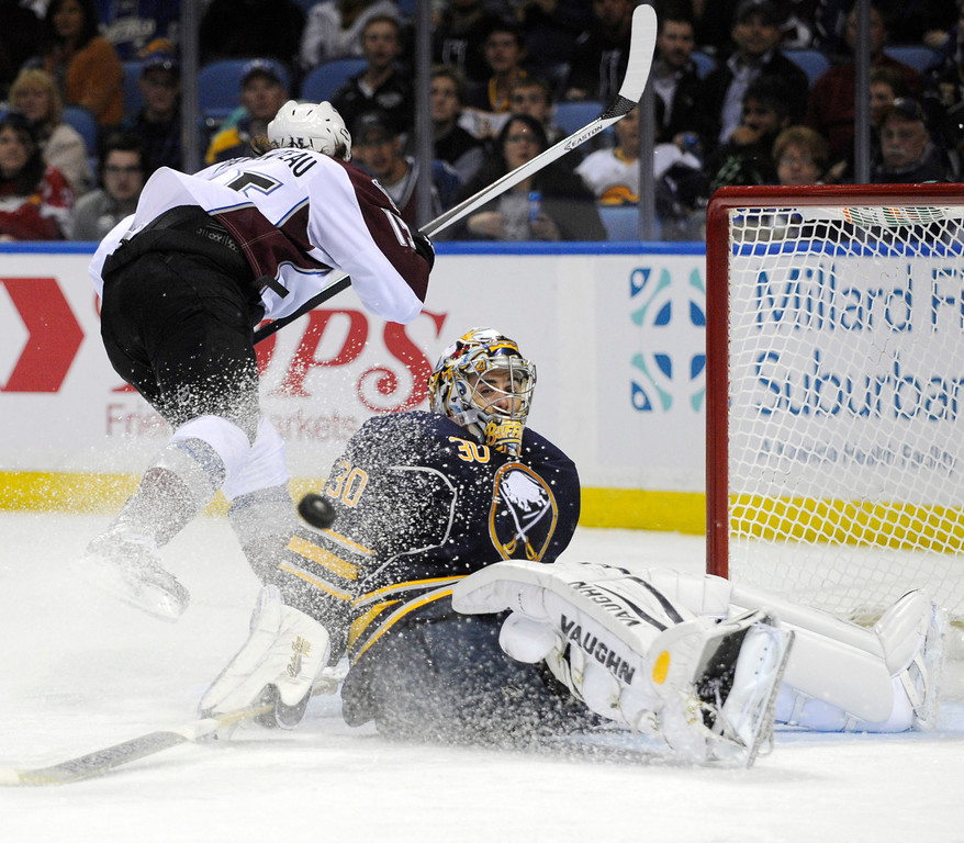 . Colorado Avalanche PA Parenteau (15) is stopped by Buffalo Sabres goaltender Ryan Miller (30) during the second period of an NHL hockey game in Buffalo, N.Y., Saturday, Oct. 19, 2013. (AP Photo/Gary Wiepert)