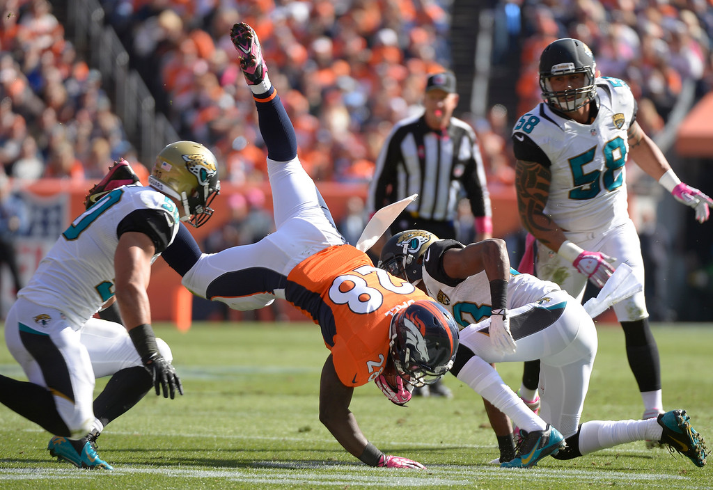 . Denver Broncos running back Montee Ball (28) is tackled by Jacksonville Jaguars cornerback Alan Ball (23) in the first quarter.  (Photo by John Leyba/The Denver Post)