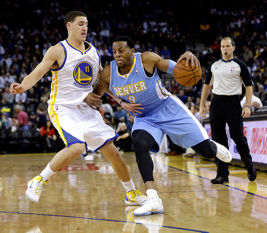 . Denver Nuggets\' Andre Iguodala (9) is defended by Golden State Warriors\' Klay Thompson during the first half of an NBA basketball game in Oakland, Calif., Thursday, Nov. 29, 2012. (AP Photo/Marcio Jose Sanchez)