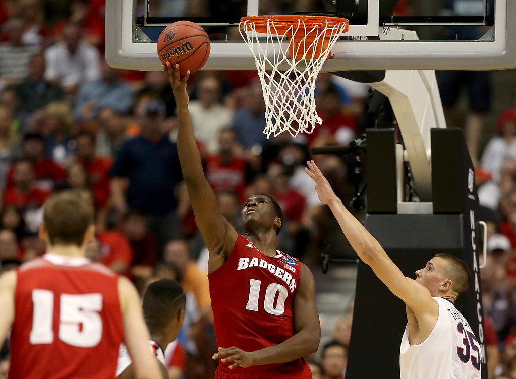 . Nigel Hayes #10 of the Wisconsin Badgers goes up for a shot against Kaleb Tarczewski #35 of the Arizona Wildcats in the second half during the West Regional Final of the 2014 NCAA Men\'s Basketball Tournament at the Honda Center on March 29, 2014 in Anaheim, California.  (Photo by Jeff Gross/Getty Images)