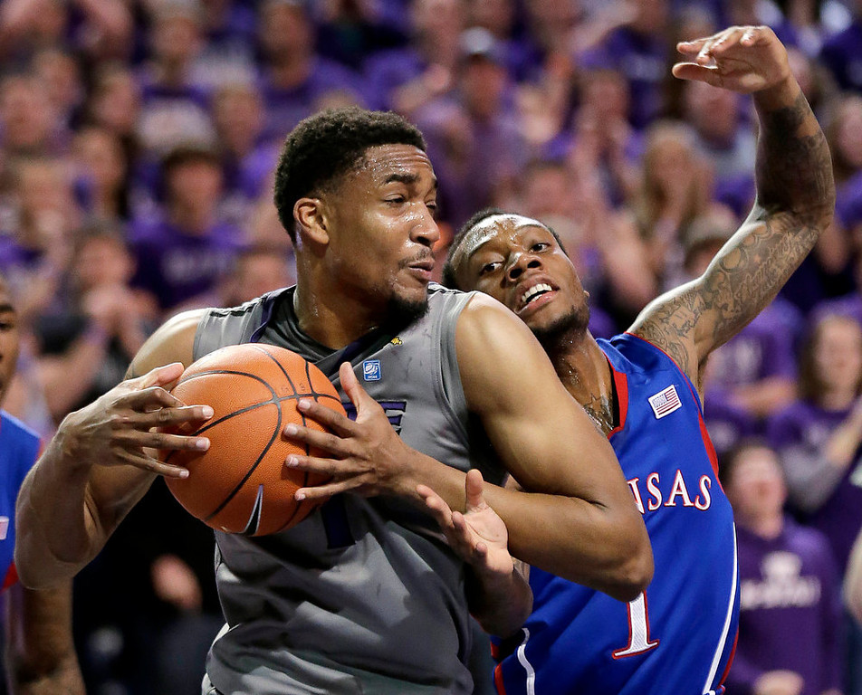 . Kansas guard Naadir Tharpe, right, tries to steal the ball from Kansas State guard Shane Southwell during the second half of an NCAA college basketball game Tuesday, Jan. 22, 2013, in Manhattan, Kan. Kansas won 59-55. (AP Photo/Charlie Riedel)