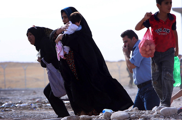 PHOTOS: Iraqis flee after extremists take Mosul, Nineveh province