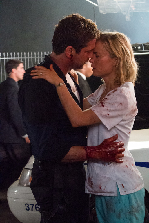 """. This film image released by FilmDisctrict shows Gerard Butler, left, and Radha Mitchell in a scene from \""""Olympus Has Fallen.\"""" (AP Photo/FilmDistrict, Phil Caruso)"""