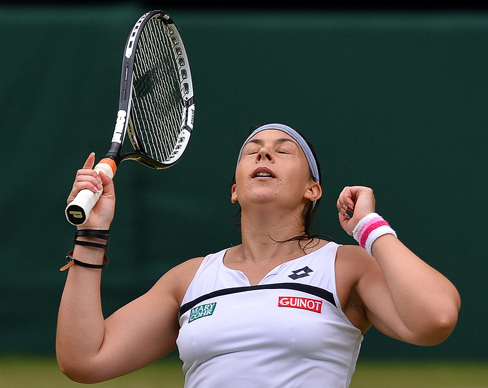 . France\'s Marion Bartoli celebrates beating Belgium\'s Kirsten Flipkens during their women\'s singles semi-final match on day ten of the 2013 Wimbledon Championships tennis tournament at the All England Club in Wimbledon, southwest London, on July 4, 2013. Bartoli won 6-1, 6-2.  CARL COURT/AFP/Getty Images