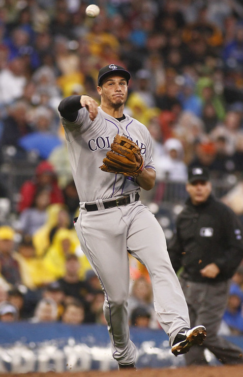 . PITTSBURGH, PA - JULY 19: Nolan Arenado #28 of the Colorado Rockies makes a throw to first base in the third inning against the Pittsburgh Pirates during the game at PNC Park July 19, 2014 in Pittsburgh, Pennsylvania. (Photo by Justin K. Aller/Getty Images)