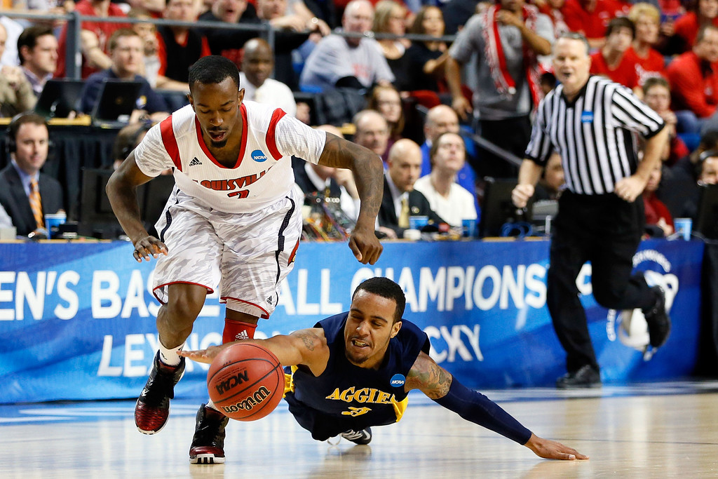 . LEXINGTON, KY - MARCH 21:  Russ Smith #2 of the Louisville Cardinals steals the ball from Jeremy Underwood #3 of the North Carolina A&T Aggies during the second round of the 2013 NCAA Men\'s Basketball Tournament at the Rupp Arena on March 21, 2013 in Lexington, Kentucky.  (Photo by Kevin C. Cox/Getty Images)