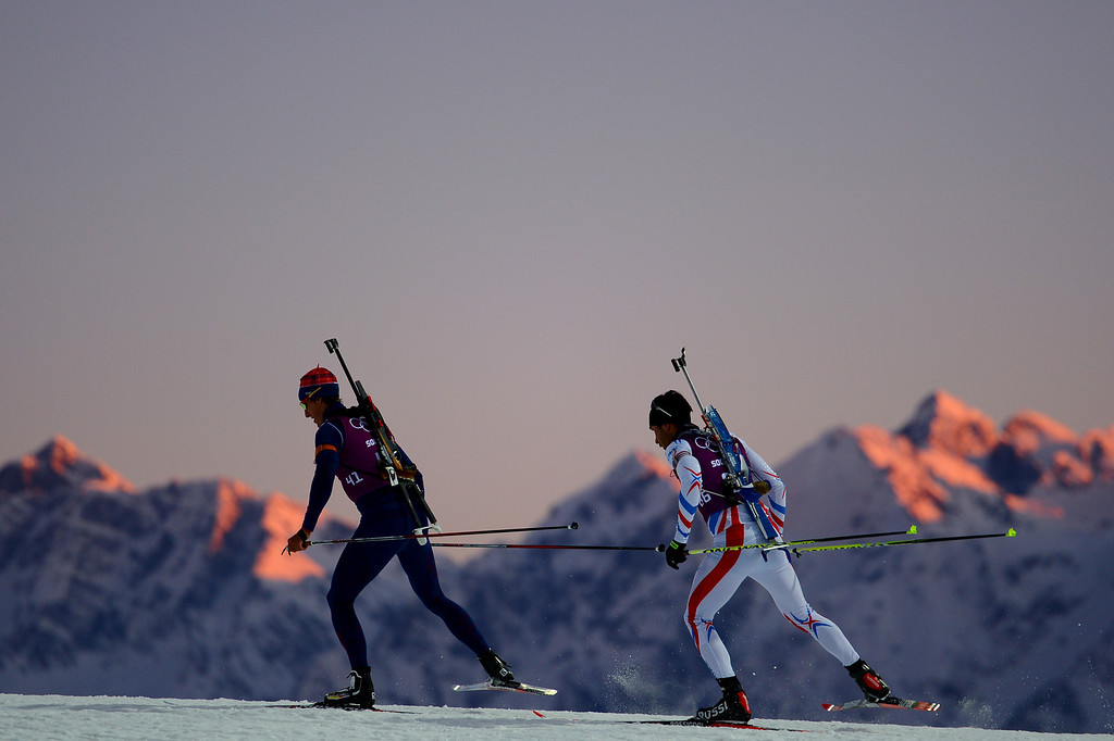 . Biathletes Lars Berger (L) of Norway and Martin Fourcade of France in training ahead of the Sochi 2014 Winter Olympics at the Laura Cross-Country Ski and Biathlon Center on February 5, 2014 in Sochi, Russia.  (Photo by Lars Baron/Getty Images)