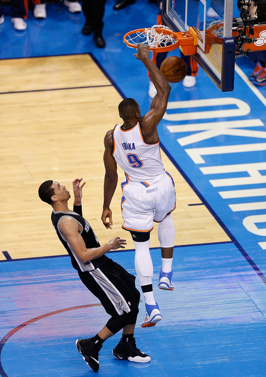 . OKLAHOMA CITY, OK - MAY 27:  Serge Ibaka #9 of the Oklahoma City Thunder goes up for a dunk against Danny Green #4 of the San Antonio Spurs in the third quarter during Game Four of the Western Conference Finals of the 2014 NBA Playoffs at Chesapeake Energy Arena on May 27, 2014 in Oklahoma City, Oklahoma. (Photo by Joe Robbins/Getty Images)