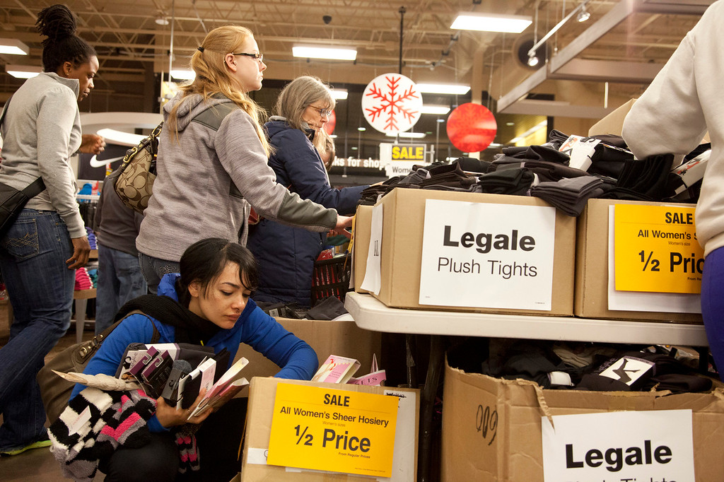 . Shoppers wade through boxes of half-price socks at the Hollywood Fred Meyer store, Friday, Nov. 29, 2013 in Portland, Ore. Black Friday, the day after Thanksgiving, is typically the nation\'s biggest shopping day of the year. (AP Photo/The Oregonian, Beth Nakamura)