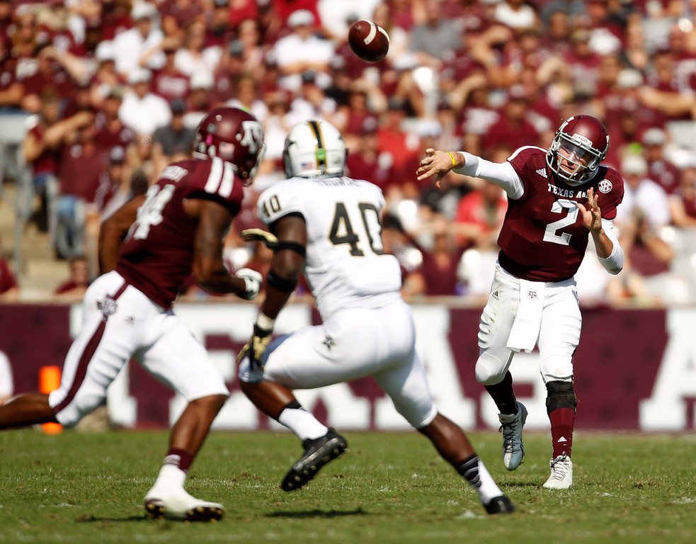 . Texas A&M\'s Johnny Manziel (2) throws a pass during the first half of an NCAA football game against Vanderbilt, Saturday, Oct. 26, 2013, in College Station, Texas. (AP Photo/Eric Christian Smith)