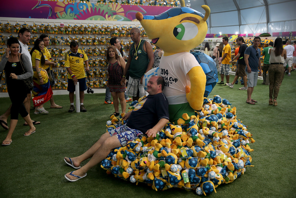 . Argentinean soccer team fan, Cesar Olmo, relaxes among stuffed toys for sale at the FIFA Fan Fest tent setup on Copacabana beach while waiting for the start of the 2014 FIFA World Cup on June 11, 2014 in Rio de Janeiro, Brazil.   Brazil continues to prepare to host the World Cup which starts on June 12th and runs through July 13th.  (Photo by Joe Raedle/Getty Images)
