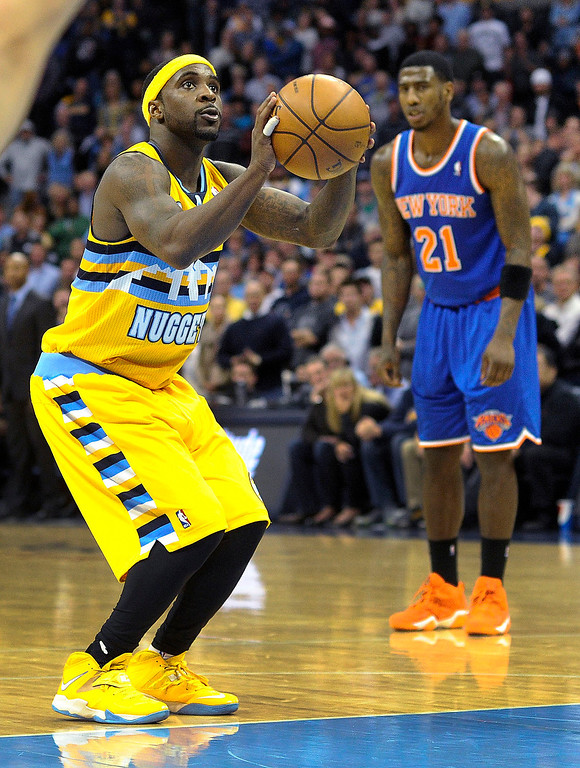 . Ty Lawson concentrated at the foul line late in the fourth quarter.   Photo By Karl Gehring/The Denver Post