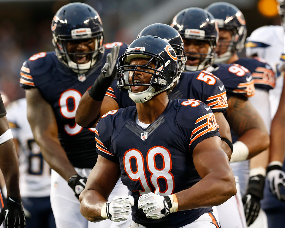 . Chicago Bears defensive end Corey Wootton (98) celebrates after sacking San Diego Chargers quarterback Philip Rivers (17) during the first half of the preseason NFL football game, Thursday, Aug. 15, 2013, in Chicago. (AP Photo/Charles Rex Arbogast)