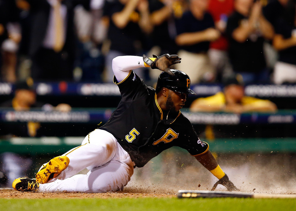 . Josh Harrison #5 of the Pittsburgh Pirates scores as a pinch runner for Justin Morneau #66 against the St. Louis Cardinals during Game Three of the National League Division Series at PNC Park on October 6, 2013 in Pittsburgh, Pennsylvania.  (Photo by Justin K. Aller/Getty Images)