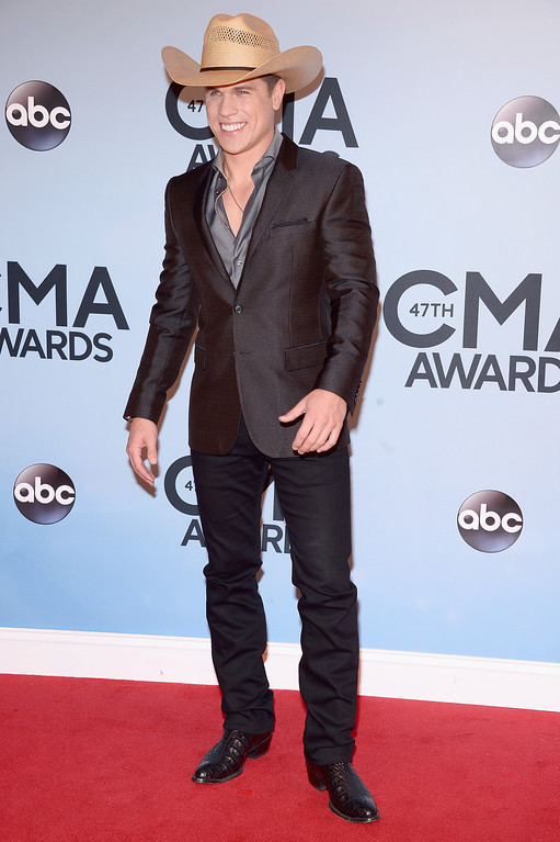. NASHVILLE, TN - NOVEMBER 06:  Dustin Lynch attends the 47th annual CMA Awards at the Bridgestone Arena on November 6, 2013 in Nashville, Tennessee.  (Photo by Michael Loccisano/Getty Images)