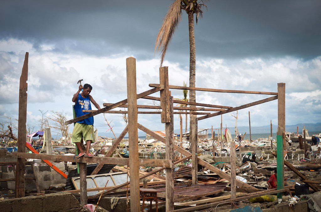 . A man tries to rebuild his hut near the shoreline following the recent super typhoon on November 21, 2013 in Tacloban, Leyte, Philippines.  (Photo by Dondi Tawatao/Getty Images)