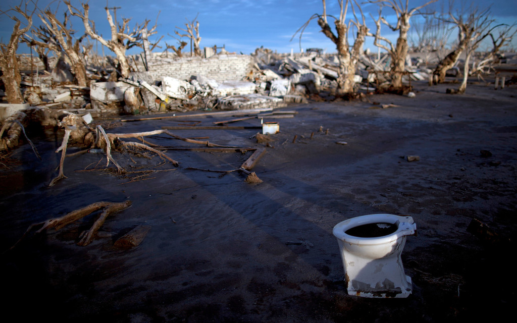 . In this May 7, 2013 photo, a toilet lays among the ruins of the village of Epecuen, which once was submerged in water in Argentina. Epecuen was once a bustling little lakeside resort, where 1,500 people served 20,000 tourists a season. During Argentina\'s golden age, the same trains that carried grain to the outside world brought visitors from the capital to relax in Epecuen\'s saltwater baths and spas. (AP Photo/Natacha Pisarenko)