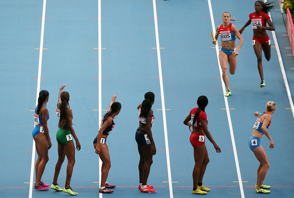. Athletes wait for the handover during the women\'s 4x400 metres relay final at the 2013 IAAF World Championships at the Luzhniki stadium in Moscow on August 17, 2013.   LOIC VENANCE/AFP/Getty Images