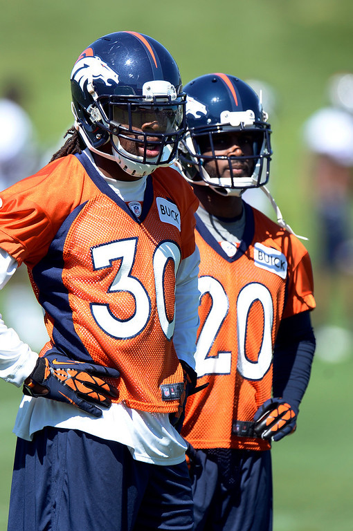 . David Bruton (30) of the Denver Broncos and Mike Adams (20) watch drills during OTAs June 6, 2013 at Dove Valley. (Photo By John Leyba/The Denver Post)