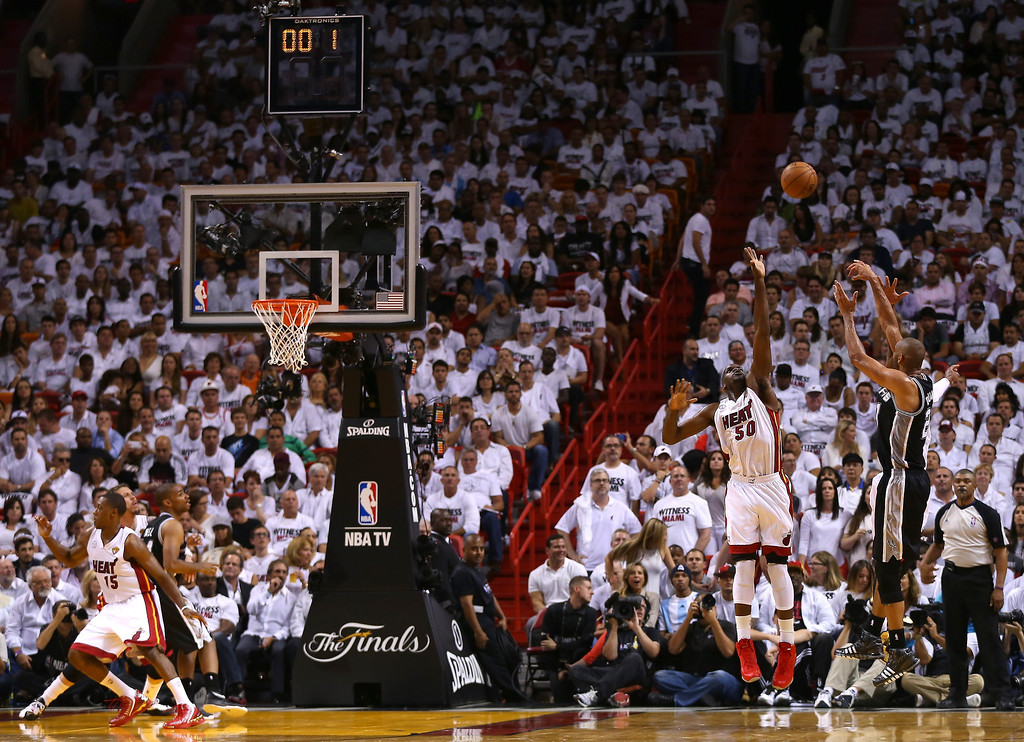. Tim Duncan #21 of the San Antonio Spurs hits a shot over Joel Anthony #50 of the Miami Heat to end the first half during Game One of the 2013 NBA Finals at AmericanAirlines Arena on June 6, 2013 in Miami, Florida. (Photo by Mike Ehrmann/Getty Images)