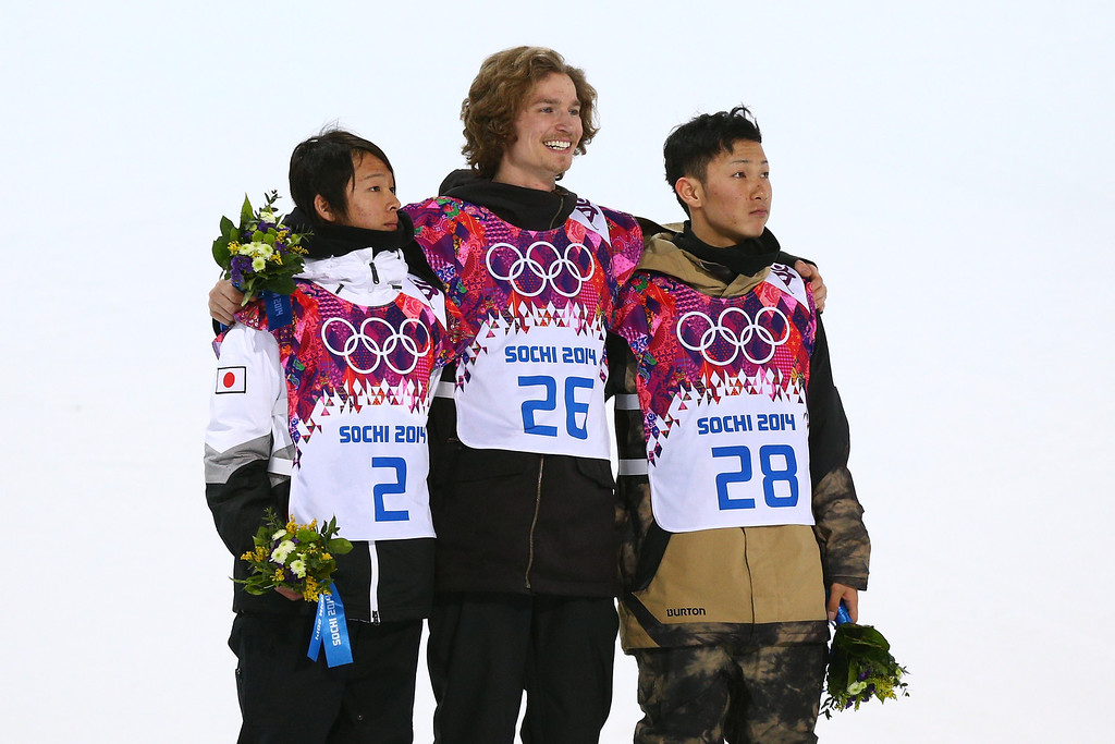 . L-R) Silver medalist Ayumu Hirano of Japan, gold medalist Iouri Podladtchikov of Switzerland and bronze medalist Taku Hiraoka of Japan celebrate on the podium during the flower ceremony for the Snowboard Men\'s Halfpipe Finals on day four of the Sochi 2014 Winter Olympics at Rosa Khutor Extreme Park on February 11, 2014 in Sochi, Russia.  (Photo by Cameron Spencer/Getty Images)