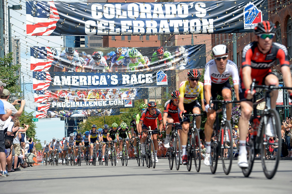 Description of . Just something different for me getting the low angle as the riders fly through Larimer Square downtown during he Pro Challenge.  DENVER, CO. - AUGUST 25 : Riders head down Larimer Square during the final stage in the USA Pro Cycle Challenge as it makes it way through downtown Denver August 25, 2013. Aspen's Tejay van Garderen wins the 3rd annual Pro Cycle Challenge. (Photo by John Leyba/The Denver Post)