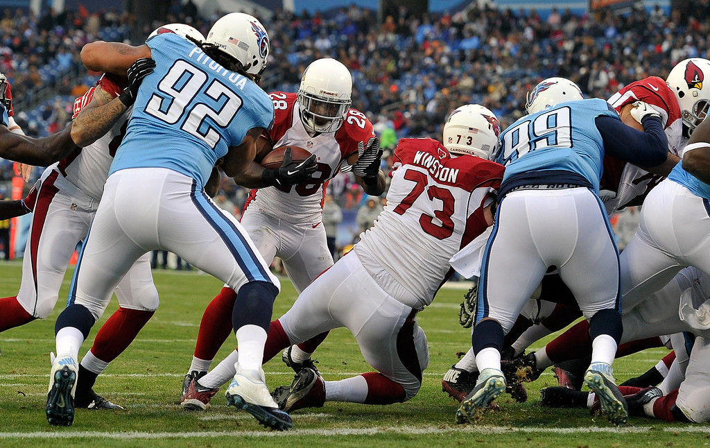 Description of . Rashard Mendenhall #28 of the Arizona Cardinals scores a touchdown against the Tennessee Titans at LP Field on December 15, 2013 in Nashville, Tennessee.  (Photo by Frederick Breedon/Getty Images)