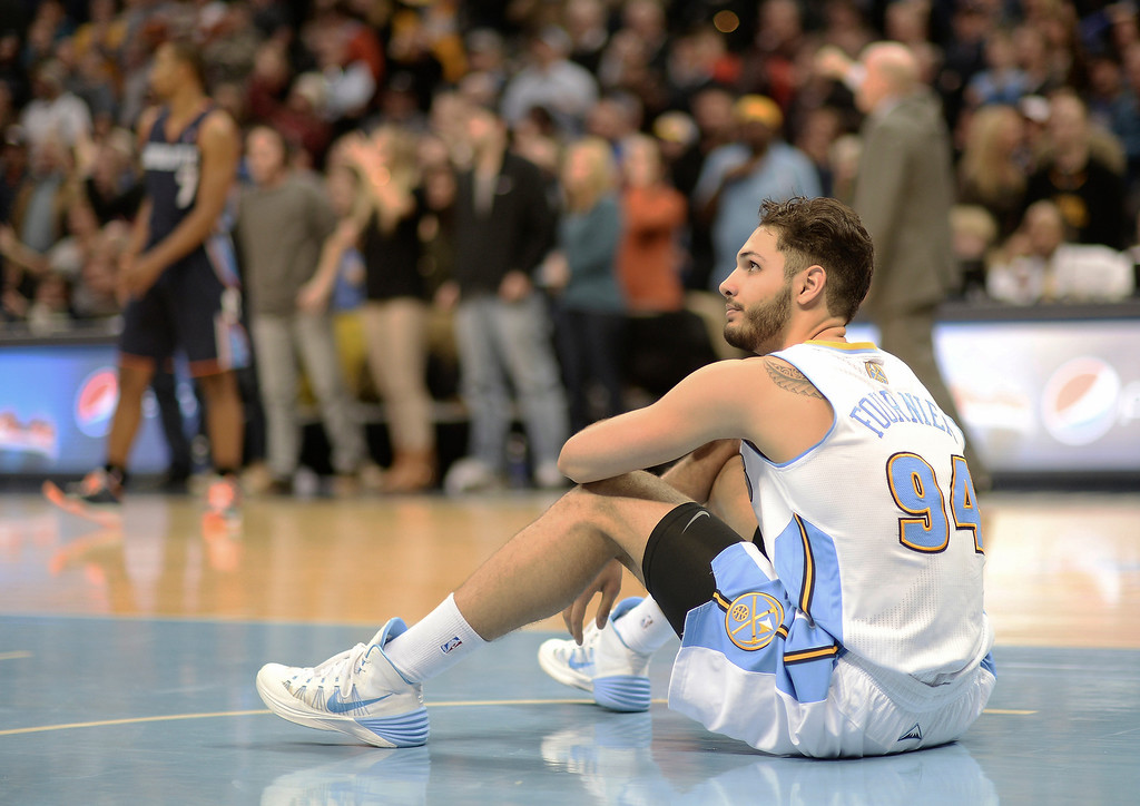 . Evan Fournier of Denver Nuggets (94) is checking score board after missed a shot during the second half. Charlotte won 101-98. (Photo by Hyoung Chang/The Denver Post)