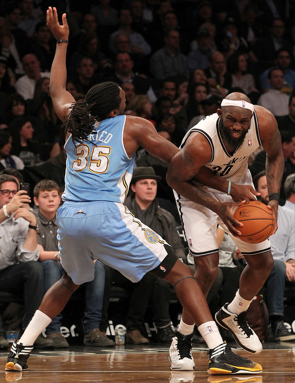 . Denver Nuggets\' Kenneth Faried (35) foouls Brooklyn Nets\' Reggie Evans during the first half of an NBA basketball game on Wednesday, Feb. 13, 2013, at Barclays Center in New York. (AP Photo/Mary Altaffer)