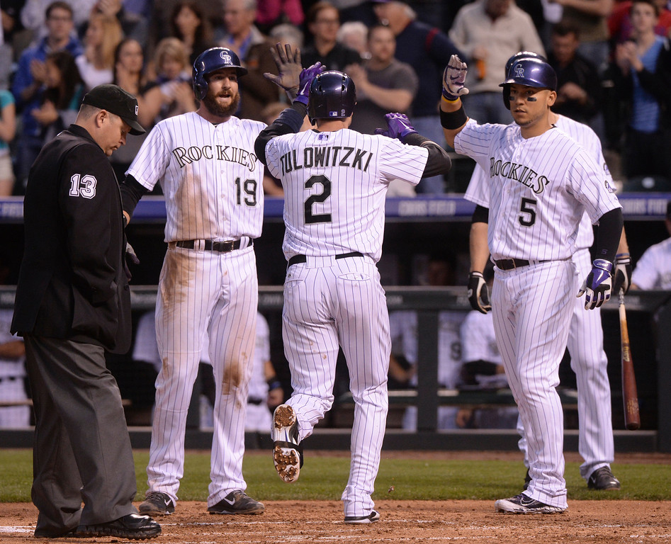 . DENVER, CO - APRIL 18: Charlie Blackmon (19) and Carlos Gonzalez (5) met Troy Tulowitzki (2) at home plate after his home run in the second inning. The Colorado Rockies hosted the Philadelphia Phillies Friday night, April 18, 2014 at Coors Field.  (Photo by Karl Gehring/The Denver Post)