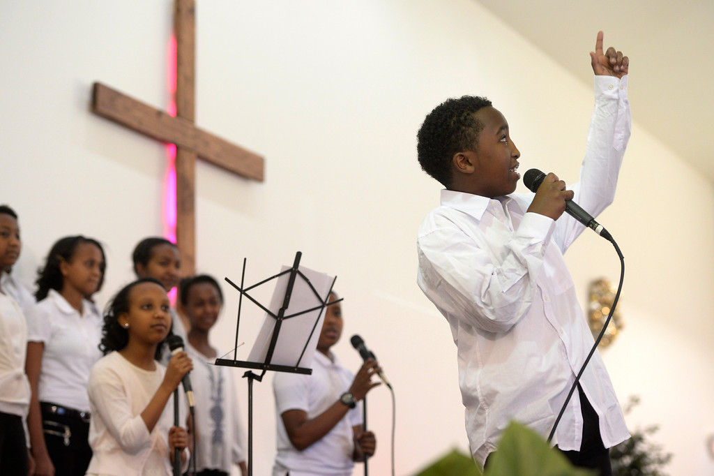 . AURORA, CO. - JANUARY 11:  Children\'s choir singer, Beneyam Yifru, 12, right, breaks out a religious rap solo singing with the choir at the Addis Kidan Evangelical Church dedication, Saturday morning, January 10, 2014. (Photo By Andy Cross / The Denver Post)