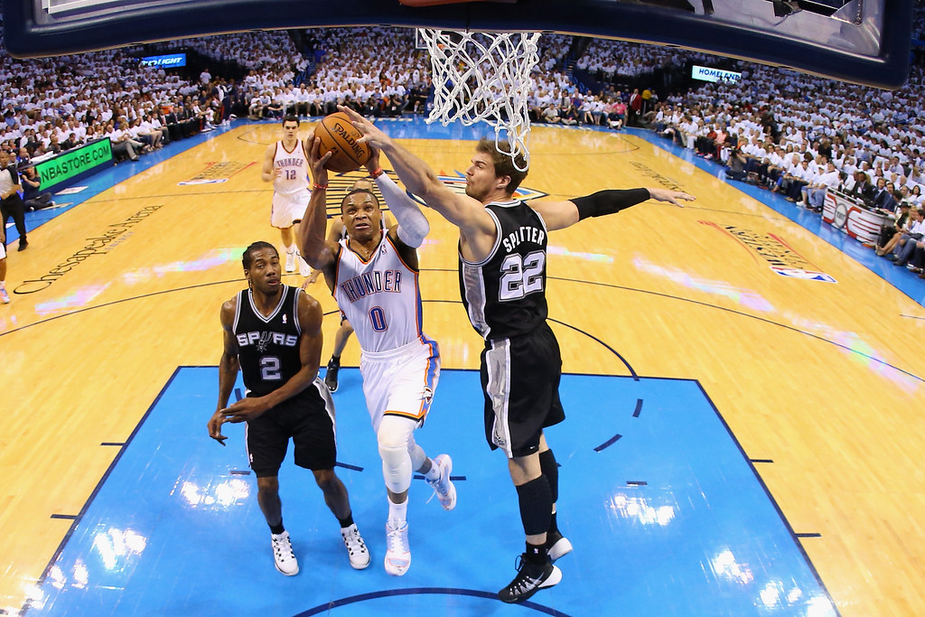 . OKLAHOMA CITY, OK - MAY 31:  Russell Westbrook #0 of the Oklahoma City Thunder battles for the ball wirh Kawhi Leonard #2 and Tiago Splitter #22 of the San Antonio Spurs in the first half during Game Six of the Western Conference Finals of the 2014 NBA Playoffs at Chesapeake Energy Arena on May 31, 2014 in Oklahoma City, Oklahoma. (Photo by Ronald Martinez/Getty Images)