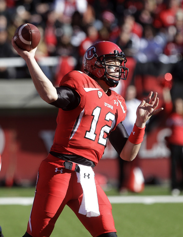 . Utah quarterback Adam Schulz (12) passes the ball in the second quarter of an NCAA college football game against Colorado Saturday, Nov. 30, 2013, in Salt Lake City. (AP Photo/Rick Bowmer)