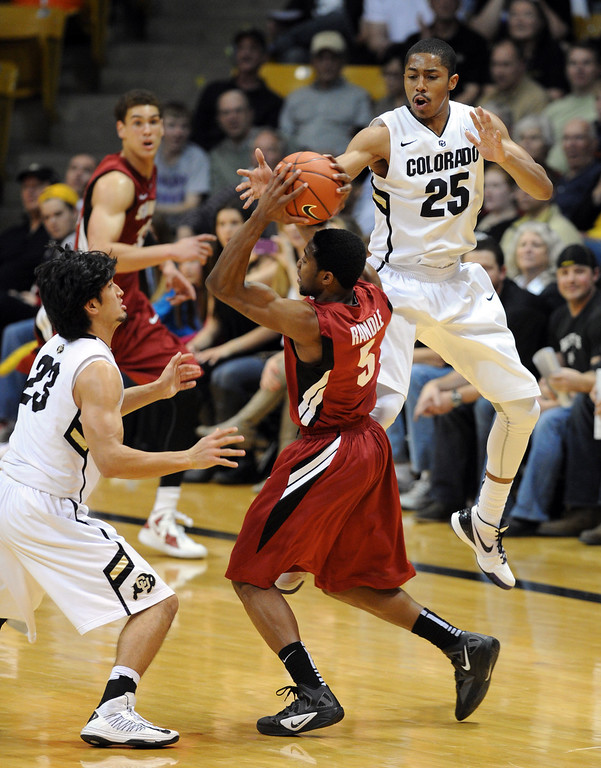. Chasson Randle of Stanford is trapped by Sabatino Chen and Spencer Dinwiddie of CU during the second half of the January 24th, 2013 game in Boulder. For more photos of the game, go to www.dailycamera.com. Cliff Grassmick / January 24, 2013