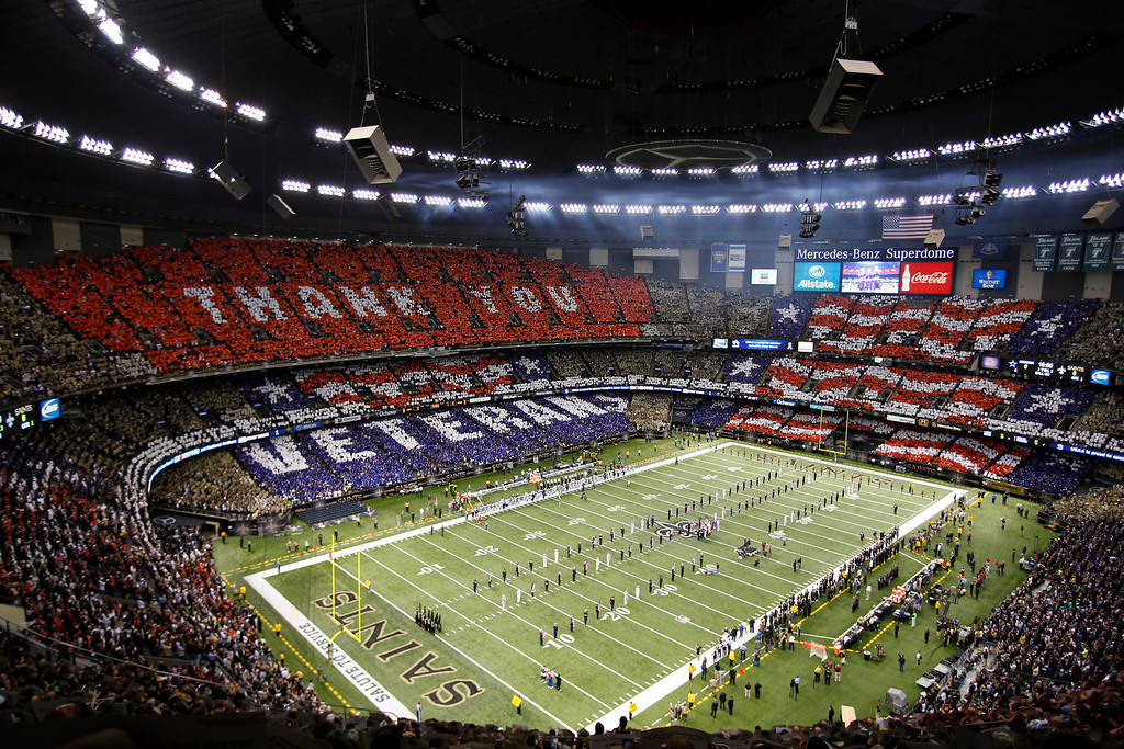 . An overall inside view of the Mercedes-Benz Superdome as fans honor military and veterans before an NFL game between the Dallas Cowboys and the New Orleans Saints, Sunday, November 10, 2013 in New Orleans. 50,000 cards were provided to fans by USAA, the official military appreciation sponsor of the NFL. (Kevin Terrell/AP Images for USAA)