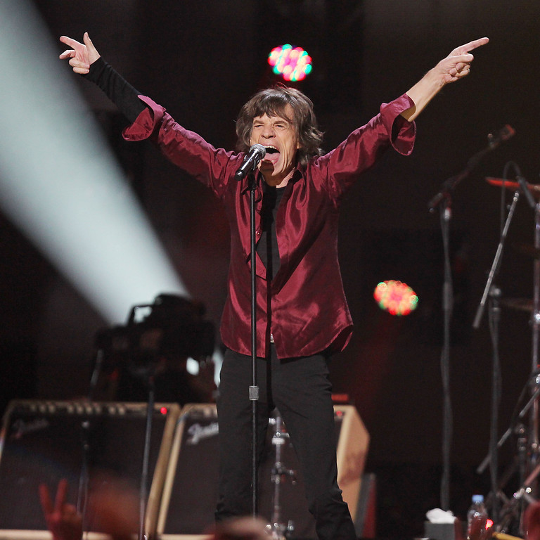 . This image released by Starpix shows Mick Jagger of The Rolling Stones performing at the 12-12-12 The Concert for Sandy Relief at Madison Square Garden in New York on Wednesday, Dec. 12, 2012. Proceeds from the show will be distributed through the Robin Hood Foundation. (AP Photo/Starpix, Dave Allocca)