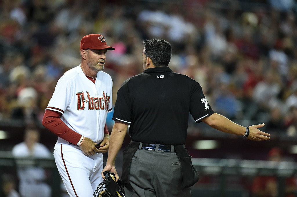 . Manager Kirk Gibson #23 of the Arizona Diamondbacks argues a call with home plate umpire Manny Gonzalez #79 during the fifth inning against the Colorado Rockies at Chase Field on August 8, 2014 in Phoenix, Arizona.  (Photo by Norm Hall/Getty Images)