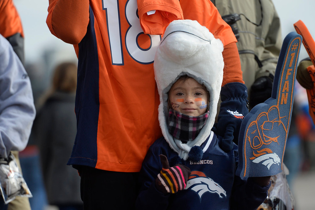 . Isabella Juarez stands with her brother Michael, from El Paso, Texas, outside the stadium. The Denver Broncos take on the San Diego Chargers at Sports Authority Field at Mile High in Denver on January 12, 2014. (Photo by Craig F. Walker/The Denver Post)