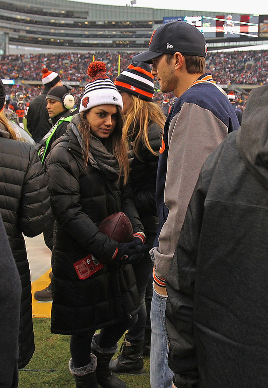 . Actors Mila Kunis and Ashton Kutcher stand on the sidleines before the Chicago Bears take on the Green Bay Packers at Soldier Field on December 16, 2012 in Chicago, Illinois. The Packers defeated the Bears 21-13. (Photo by Jonathan Daniel/Getty Images)