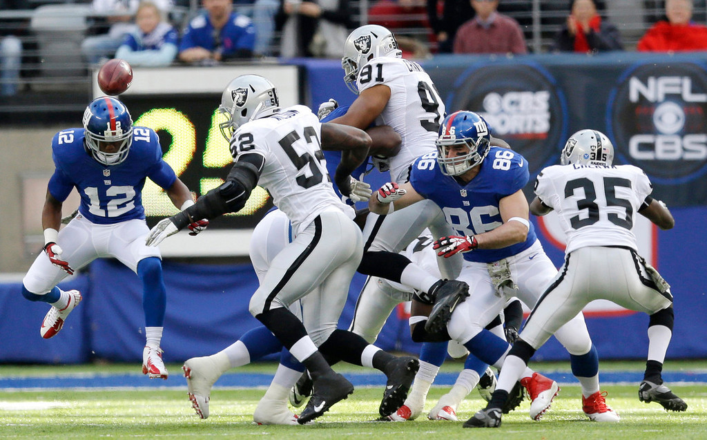 . New York Giants wide receiver Jerrel Jernigan (12) fumbles the opening kick off against the Oakland Raiders during the first half of an NFL football game, Sunday, Nov. 10, 2013, in East Rutherford, N.J. (AP Photo/Julio Cortez)
