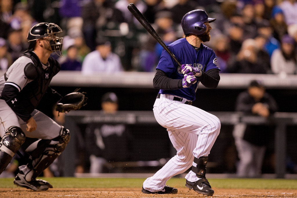 . Charlie Blackmon #19 of the Colorado Rockies watches his RBI sac-fly as catcher Tyler Flowers #21 of the Chicago White Sox looks on during the fifth inning at Coors Field on April 7, 2014 in Denver, Colorado. (Photo by Justin Edmonds/Getty Images)