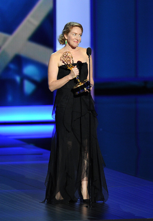 . Sarah Bromell wife of Henry Bromell accepts his award for Best Writing for a Drama Series on his behalf onstage during the 65th Annual Primetime Emmy Awards held at Nokia Theatre L.A. Live on September 22, 2013 in Los Angeles, California.  (Photo by Kevin Winter/Getty Images)