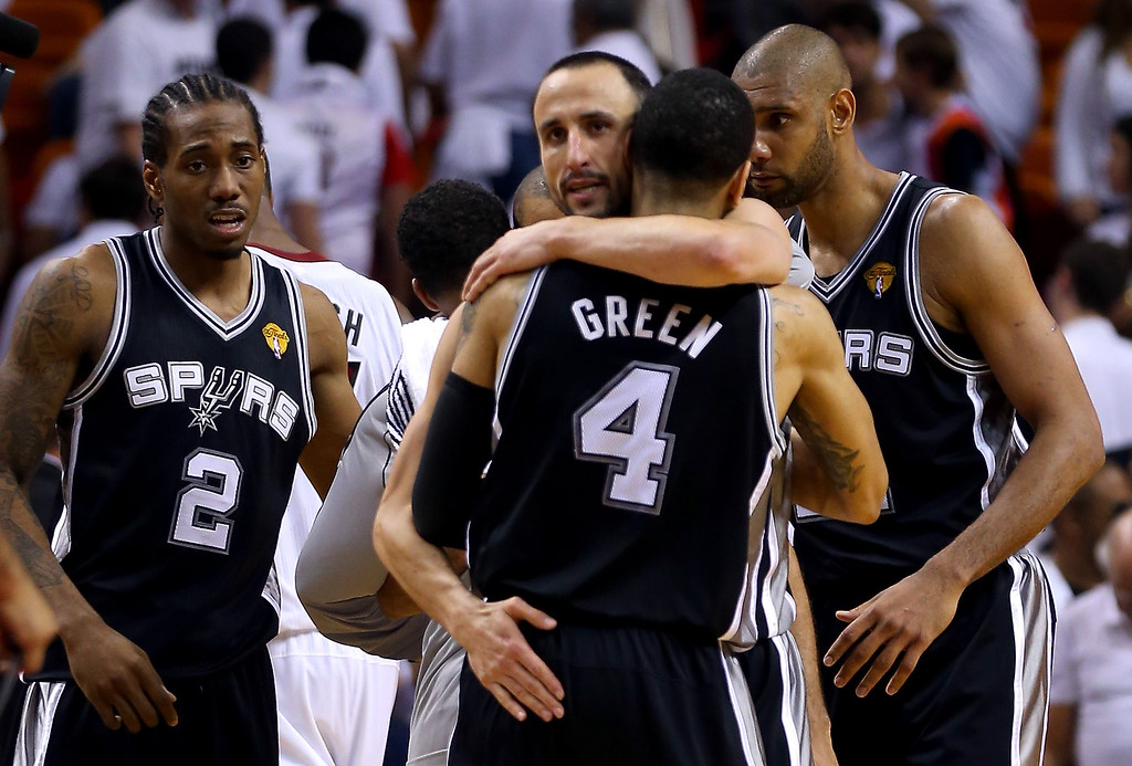 . Manu Ginobili #20 hugs Danny Green #4 of the San Antonio Spurs after the Spurs defeat the Miami Heat 92-88 in Game One of the 2013 NBA Finals at AmericanAirlines Arena on June 6, 2013 in Miami, Florida.  (Photo by Mike Ehrmann/Getty Images)