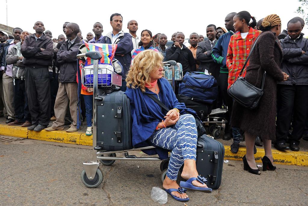 . Stranded passengers wait outside the Jomo Kenyatta International Airport in Nairobi on August 7, 2013.  AFP PHOTO / StringerSTRINGER/AFP/Getty Images
