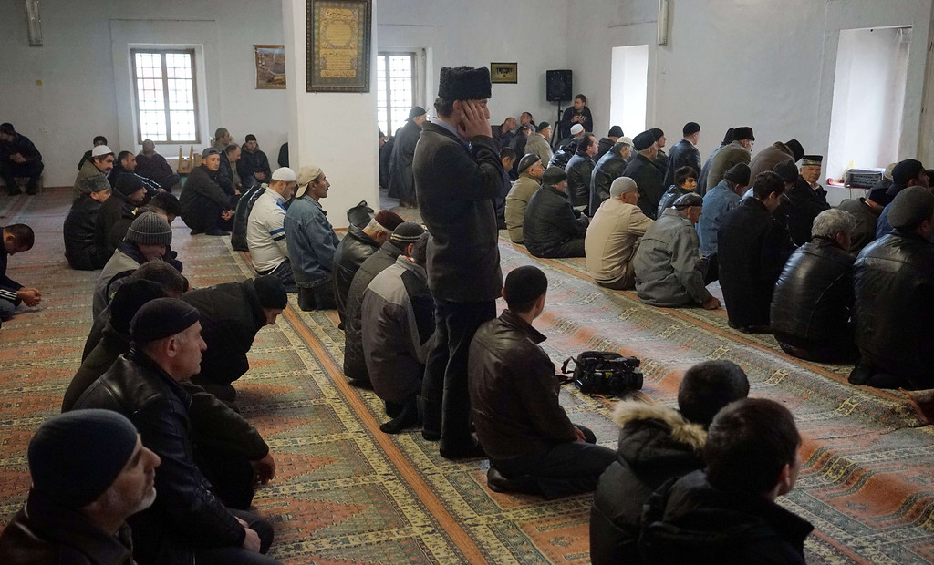 . Crimean Tatars pray at the Han mosque in the small Crimean city of Bakhchysarai on March 7, 2014. Bakhchysarai, where most residents are Crimean Tatars, is the former capital of the Crimean Khanate. Armed men at a checkpoint flying the Russian flag blocked OSCE observers from entering Ukraine\'s flashpoint Crimean peninsula for a second day on Friday, an AFP reporter said. GENYA SAVILOV/AFP/Getty Images