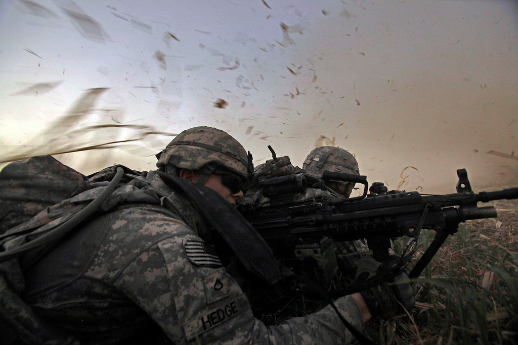 . In this Monday, Aug. 8, 2011 photo, U.S. Army Pvt. 1st Class David Hedge from Bealeton, Va., front, and fellow soldiers from 1st Battalion, 18th Infantry Regiment  are bathed in rotor wash moments after arriving by Blackhawk helicopter for an operation to disrupt weapons smuggling in Istaqlal, north of Baghdad, Iraq. A radical anti-American Shiite cleric was calling on U.S. troops in Iraq to leave the country and go back to their families or risk more attacks. The rare statement by Muqtada al-Sadr was translated into English and posted on his website. In it, the powerful Iraqi cleric appeals directly to the roughly 46,000 U.S. troops still in the country at the time. (AP Photo/Maya Alleruzzo)
