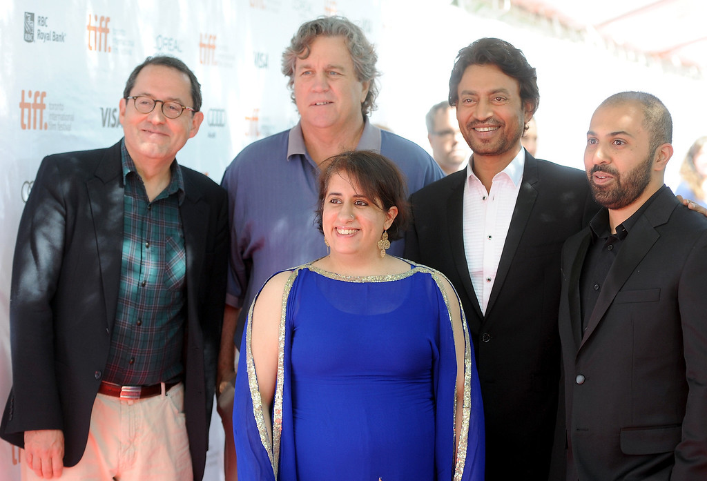 ". (L-R) Co-Presidents of Sony Pictures Classics Michael Barker and Tom Bernard, producer Guneet Monga (front),  actor Irrfan Khan, and director Ritesh Batra arrive at the ""The Lunchbox\"" Premiere during the 2013 Toronto International Film Festival at Roy Thomson Hall on September 8, 2013 in Toronto, Canada.  (Photo by Jag Gundu/Getty Images)"