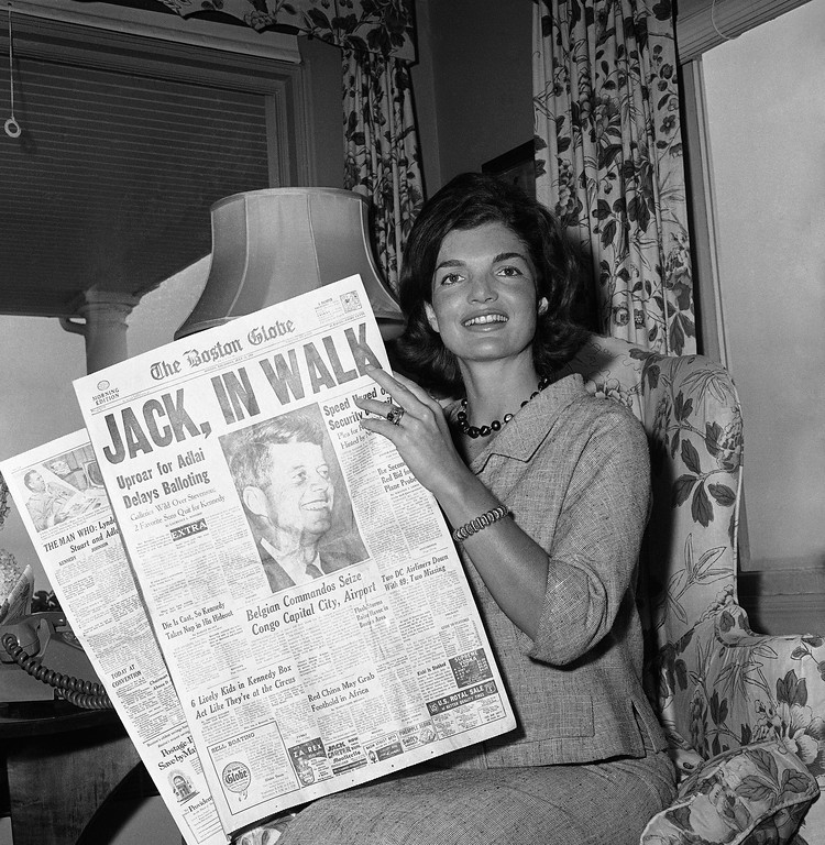 . Jackie Kennedy reads the morning paper announcing her husband\'s nomination victory at the Democratic convention on July 14, 1960.   Bill Chaplis, Associated Press file